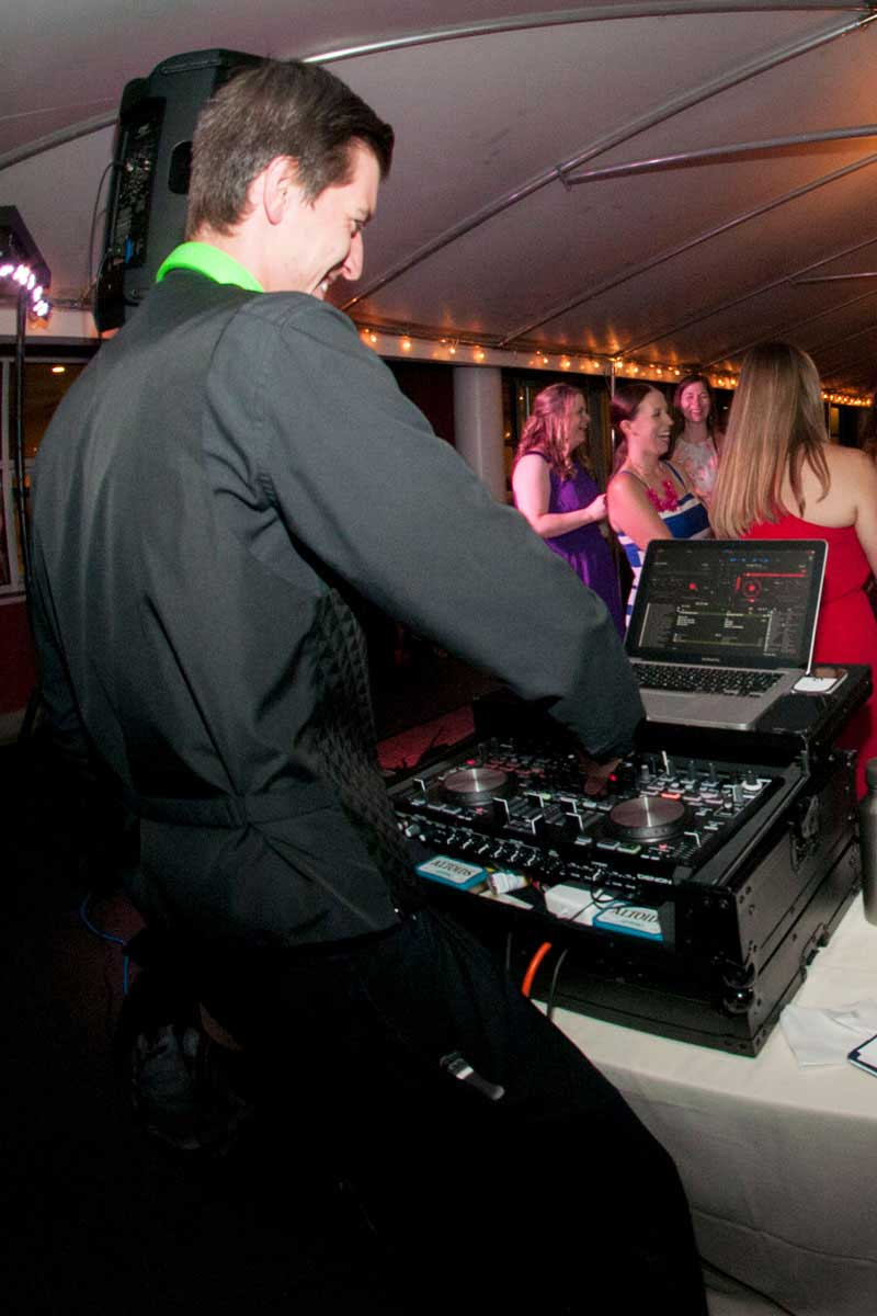 A Toy Bros DJ is performing at an outdoor tent reception in Buffalo, NY