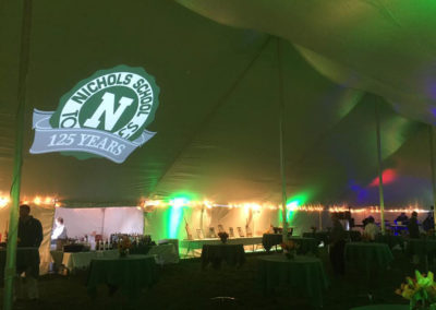 School Logo is projected on the roof of a tent for an event held to celebrate 125 of the Nichols School in Buffalo