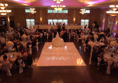 wedding monogram projected on dance floor