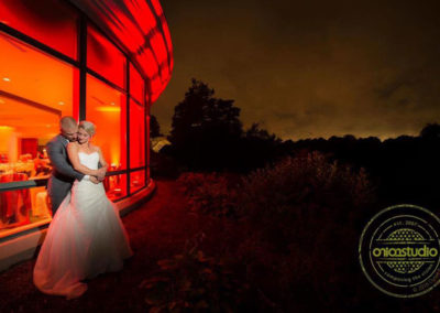 Amber Uplighting creates the most beautiful backdrop for this couple's wedding photo