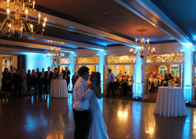 The dance floor is aglow with ice blue uplighting as this couple enjoys their first dance