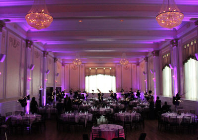 Purple Uplighting graces a ballroom set for a wedding reception in Buffalo NY